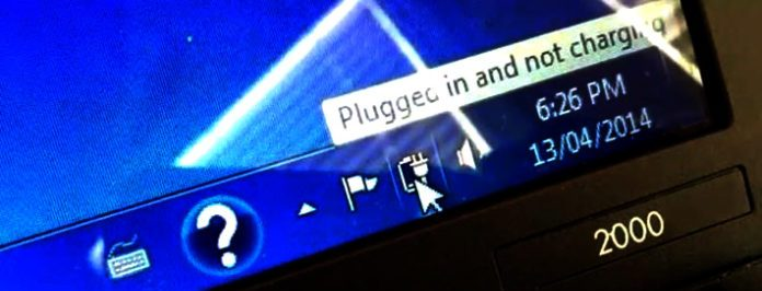 Why is my laptop plugged in and not charging?